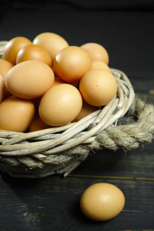 Organic brouw chicken eggs from free-range farm in wicked basket