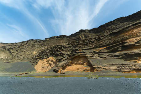 golfo: View into a volcanic crater with its green lake near El Golfo, Lanzarote island, Spain - travel destinarion Stock Photo