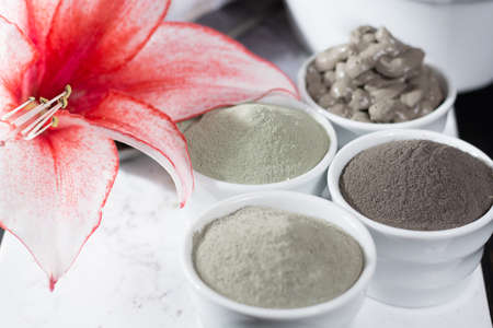 Ancient minerals - luxury face and body spa treatment, clay powder and mask , green, blue and black clay Standard-Bild