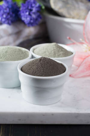 Ancient minerals - luxury face and body spa treatment, clay powder and mask , green, blue and black clay Stock Photo