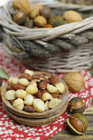 Roasted salted nuts mix, snack from macadamia, walnotes and almonds and unshelled nuts