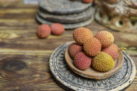 Tropical fruit - Lychees on wooden background Stock Photo