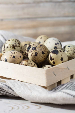albumen: Small quail eggs in wooden box, Easter concept, diet meal Stock Photo
