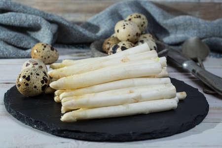 Spring season, diet meal - fresh white asparagus and quail eggs Stock Photo
