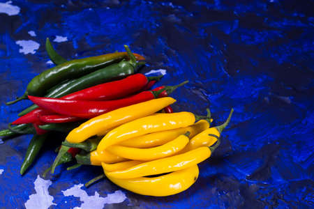 Red, green and yellow mexican hot chili peppers top view Stock Photo