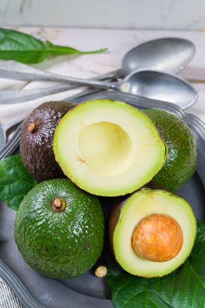 Green fresh avocado from organic avocado plantation - healthy food Stock Photo