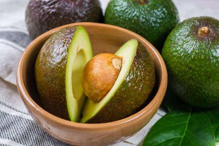 Green fresh avocado from organic avocado plantation - healthy food Stock Photo