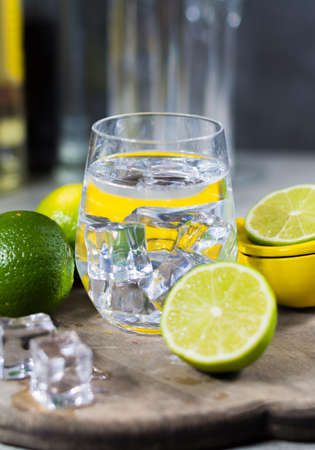 Lime manual press for preparation of cocktails, limes and glass with ice cubes, party time Stock Photo