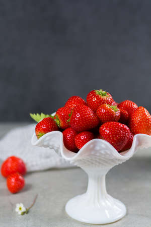 Fresh ripe strawberry. Red strawberry and blossom. Loosely laid strawberries in different positions. Stock Photo