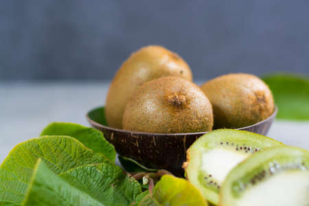 Tropical ripe organic sweet green kiwi fruit with leaves ready to eat