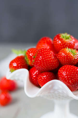 Fresh ripe strawberry. Red strawberry and blossom. Strawberry Juice. Loosely laid strawberries in different positions.