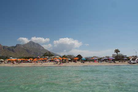 capo: Beautiful white sand beach in San Vito lo Capo, Sicily, Italy with umbrellas
