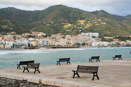 tyrrhenian: Touristic and vacation pearl of Sicily, benches in harbor of small town  Cefalu, Sicily, south Italy