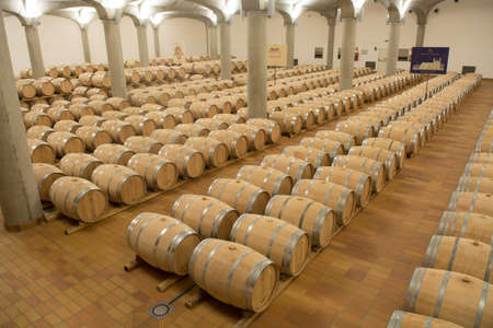 Wine barrels stacked in the cellar of the winery, Marsala, Sicily Editorial