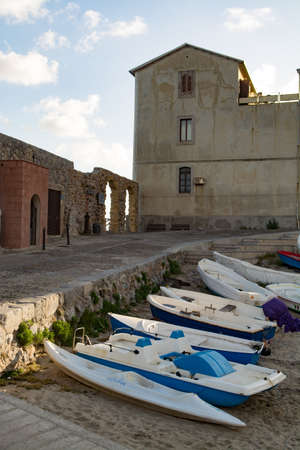 Touristic and vacation pearl of Sicily, fishermen boats in small town of Cefalu, Sicily, south Italy
