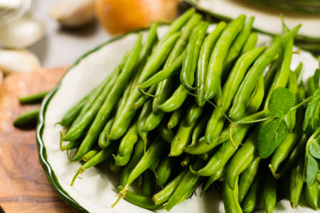 snap bean: Fresh green snap beans on the plate ready to cook, healthy food