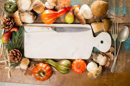 Autumn dinner concept - cutting board with copy space - fresh porcini boletus oak muchrooms, high quality,restaurant menu, a la carte