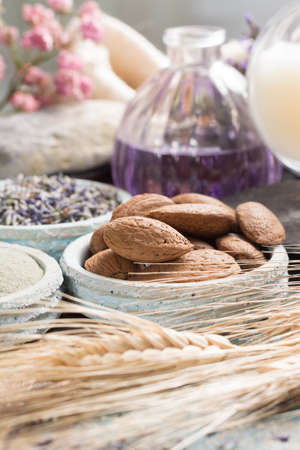Nature cosmetics, handmade preparation with essential oils and ancient minerals of  parfums, skincare, creams, soaps from fresh and dried lavender flowers, roses, wheat, almond nuts, green clay powder in French artisanal boutique home style Stock Photo