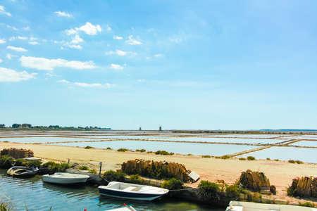 Sea saltworks, salt wind mills are seen in suburbs of Marsala, Sicily, Italy. Stock Photo