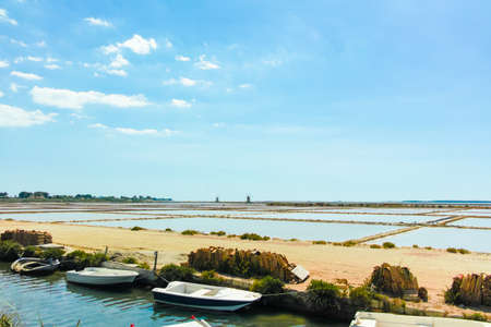 museum visit: Sea saltworks, salt wind mills are seen in suburbs of Marsala, Sicily, Italy. Stock Photo
