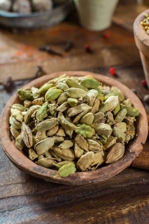 Most expensive spice in the world – dried green cardamom pods with black seeds, used as an ingredient in many cuisines and for medical use close up