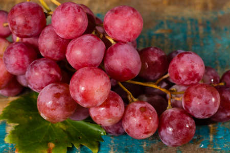 white washed: Bunch of large organic table grapes Red Globe  close up