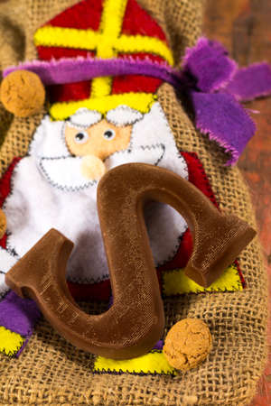 saint nicolas: Traditional Dutch Saint Nicolas celebration with presents for children in December, Saint Nicolas  gift bag and chocolate letters close up