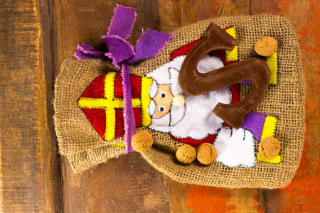 Traditional Dutch Saint Nicolas celebration with presents for children in December, Saint Nicolas  gift bag and chocolate letters close up