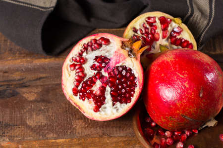 Healthy fruit red  pomegranate, rich of Vitamin C, also known as a symbol of prosperity, fertility and used in traditional medicine