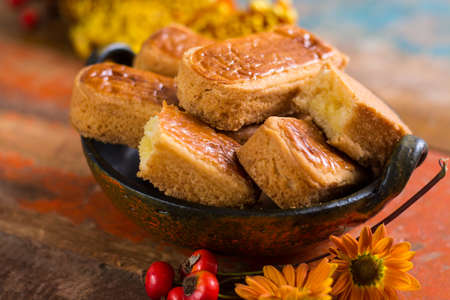 Autumn dessert, stuffed cookies on the wooden table with autums colors decoration,  Thanksgiving food concept