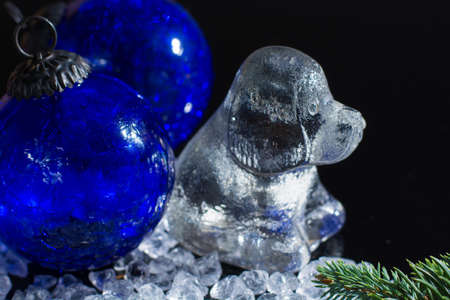 Black and white, Chine horoscop, 2018 New Year of dog, glass dog figure and clbalt blue ball, copy space