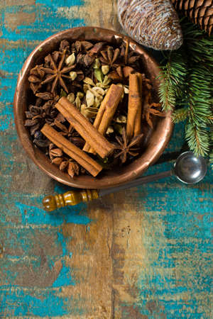 Collection of spices for winter and Christmas days, used for baking and mulled wine on wooden table