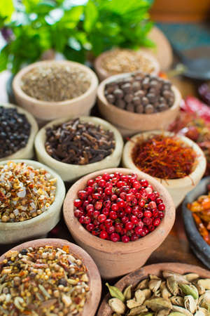 Variety of different asian and middle east spices, colorful assortment, on old wooden table, close up Standard-Bild - 90947164