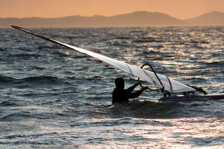 Sunset over the sea or ocean and extreme freestyle sport windsurfing, France, Giens Banco de Imagens
