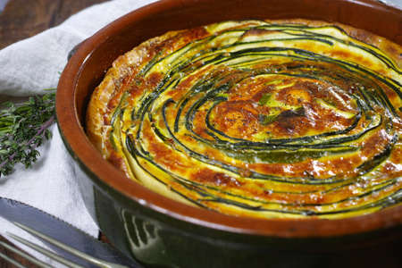 Homemade traditional quiche vegetable pie with green courgette and carrot Stock Photo