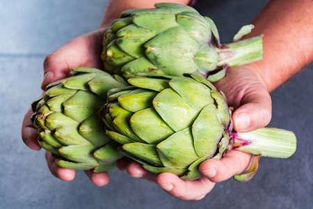 Green ripe raw big artichokes heads ready to cook