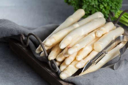 Spring season, new harvest of Dutch, German white asparagus, bunch of raw white asparagus