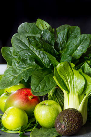 Fresh green vegetables and fruits, ingredients for dietary healthy detox green smoothie or salad