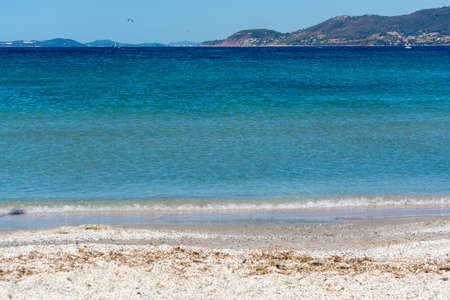 Beautiful beach French Riviera with blue water and white sand, vacation destination