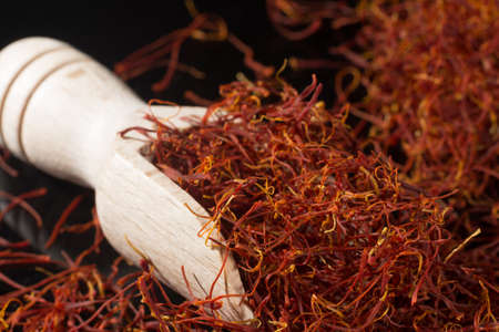 Macro collection, expensive real dried saffron spice close up on black background Standard-Bild - 95914729
