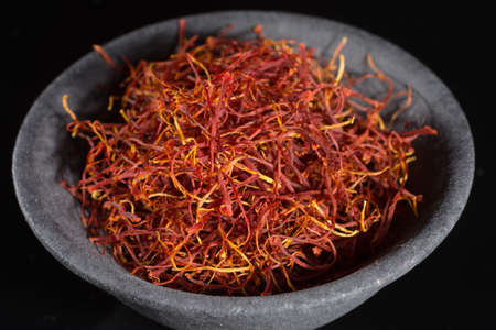 Macro collection, expensive real dried saffron spice close up on black background Standard-Bild - 95948965