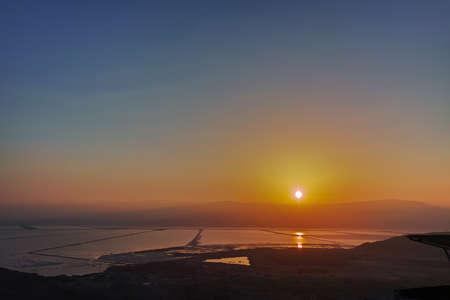 Sunrise over lowest salty lake in world below sea level Dead sea