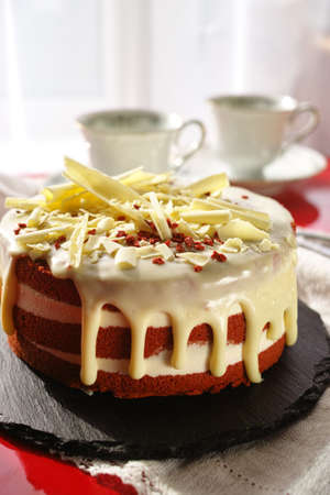 Classic American dessert red velvet cake is traditionally a red, red-brown chocolate layer cake, layered with white cream cheese or ermine icing from bakery.