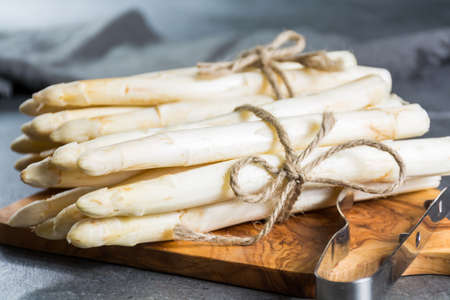 Spring season, new harvest of Dutch, German white asparagus, bunch of raw white asparagus Reklamní fotografie - 97229347