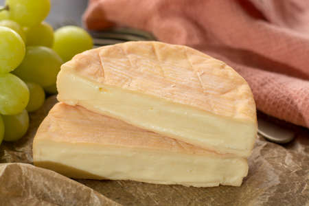 French soft strong smelling cheese Munster from Alsace close up Stock Photo