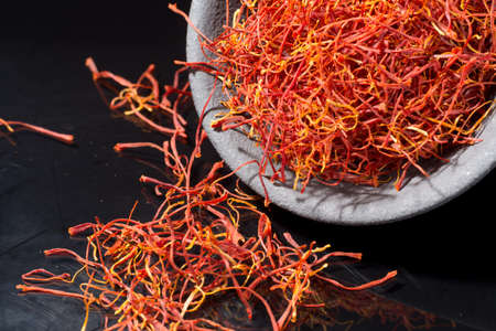 Macro collection, expensive real dried saffron spice close up on black background