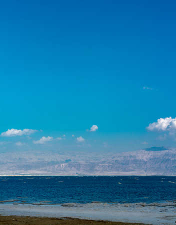 Panorama photo of lowest salty lake in world Dead sea, full of minerals near luxury vacation resort Ein Bokek, place for medical treatments, climatotherapy, thalassotherapy and heliotherapy.