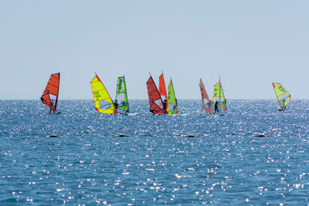 Group of windsurfers is Red sea near Eilat, Israel, water sport and recreation