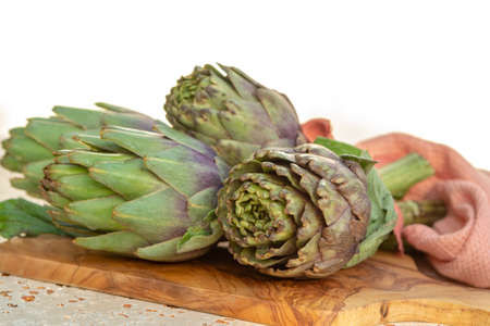 Traditional Italian food, fresh green artichoke vegetables, new harvest, uncooked