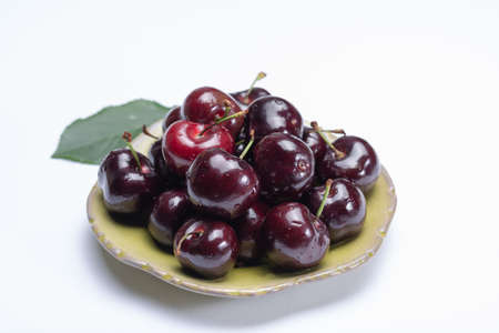 Giant fresh ripe black cherries, new harvest, ready to eat close up